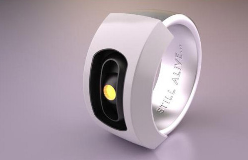 "gamefreaksnz:  GLaDOS Ring: Wear This, You Monster  It's even got the inscription inside ""STILL ALIVE…"" While the image above shows a lovely full color GLaDOS, keep in mind that this 3D printed ring will come in a solid color. So if you want it to look that awesome, you'll need to buy it in white and dig out the fine-tip paintbrush. Or you could go for the shiny steel, silver or gold plated versions for some added sparkle. The GLaDOS ring was designed by QUATRO, and is available from Shapeways. Prices for the ring range from $17.80 to $92(USD), depending on the material you select, and you can order the ring in a variety of sizes – yet another wonder of 3D printing. And if you'd prefer a pendant to a ring, QUATRO has you covered too."