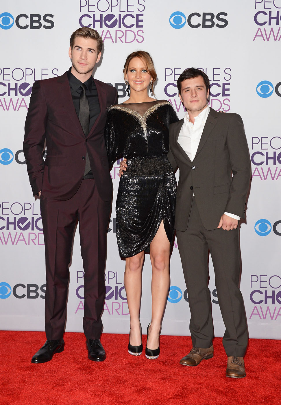 verysherry:  Liam Hemsworth, Jennifer Lawrence and Josh Hutcherson || 39th Annual People's Choice Awards in LA on January 9, 2013  EEEE! Josh Hutcherson is so adorably teeny! Liam should carry him around in his pocket!