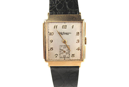 "Swiss-made 14k gold Jules Jurgensen mechanical watch in good working order on genuine crocodile strap, with jeweled movement. Case marked ""14K"" on interior. Measures 9""L with strap. by Ruby + George on One Kings Lane Vintage and Market Finds"