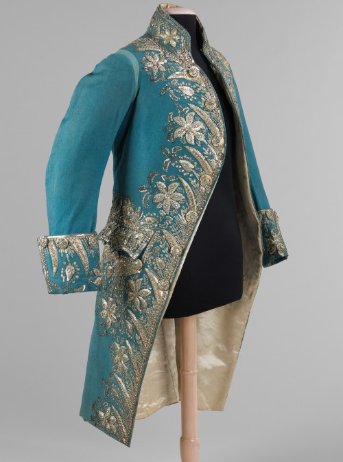 fashioninhistory:  Court Coat 1775-89 The elegance and grandeur of 1770s and 80s court dress is displayed in this court coat. The magnificent array and abundance of silver decorations used to adorn the jacket would have sparkled in flickering candlelight and indicated the status of the wearer who could afford such an expensive garment.
