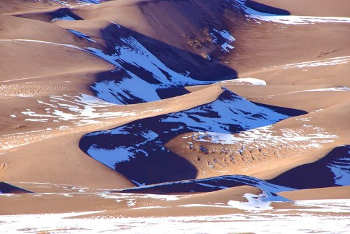 A sure sign of spring. The snow is melting on the sand dunes at the Great Sand Dunes National Park.Photo: Patrick Myers, NPS