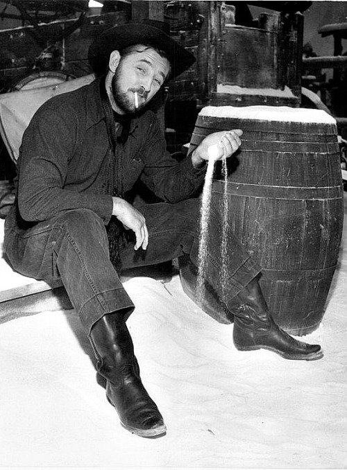 "Robert Mitchum plays with fake snow, which was a combination of gypsum and bleached corn flakes, on the set of Track of the Cat, 1954.  #*""whatta man"" by salt n pepa plays in the background*"