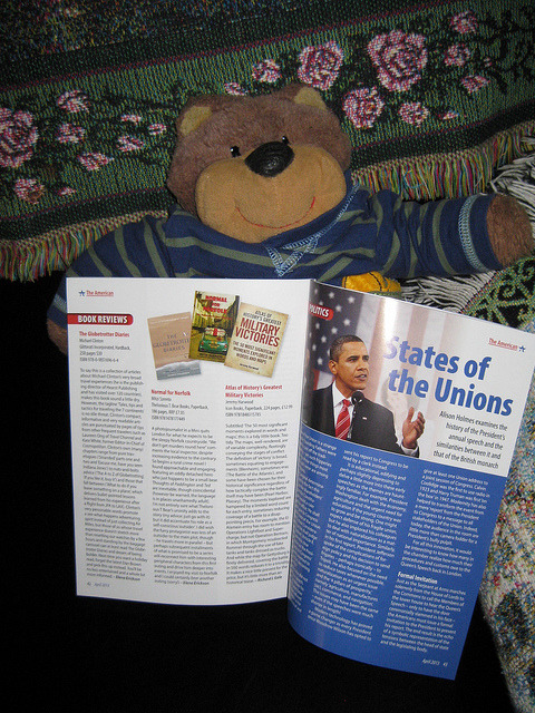 Teddy Tedaloo checks out his book review in The American magazine on Flickr.
