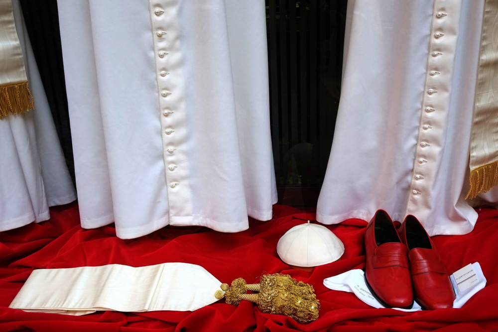March 4, 2013. Vestments for the new Pope to be elected are displayed in the window of Italian ecclesiastical tailor Gammarelli in Rome.  (Photo: Alberto Pizzoli—AFP/Getty Images) From the death of Venezuelan president Hugo Chavez and elections in Kenya to violent protests in Bahrain and International Women's Day around the world, TIME presents the best images of the week. See more of TIME's best pictures of the week.