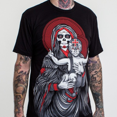 "Just released a red version of the ""Our Lady of Luchadores"" shirt in the ol' online store. Thanks to everyone who grabbed all the yellow ones!"