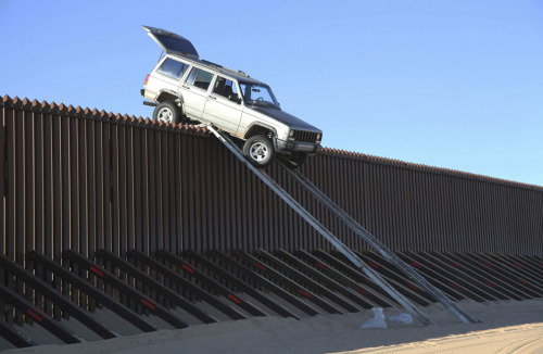 Smugglers Stuck on Makeshift Ramp over US-Mexico Border Fence, Yuma, AZ, 2012(via atlantic)