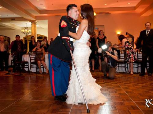 Town throws dream wedding for triple amputee Marine (Photo: RK Green Studios) Juan Dominguez lost his both his legs and his right arm after stepping on improvised explosive device while serving as a Marine Corporal in Afghanistan in 2010. But that didn't stop him from finding true love a few months later, when he met his now-wife Alexis after returning to the States. Read the complete story.