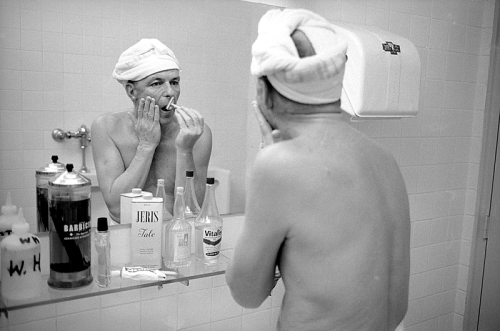 Frank Sinatra, shaving, 1965.   LIFE photographer John Dominis spent weeks with Sinatra in 1965 — the year the singer turned 50 — emerging with one of the most revealing photographic records of any major performer's private world ever captured on film. From rehearsals in smoke-filled recording studios to Vegas nightclub performances to golf in the Nevada sun to playing with his dog Ringo in his home office to late-night hijinks with his drinking buddies. Virtually every frame Dominis shot makes it clear that, when Sinatra was around, no one else mattered.
