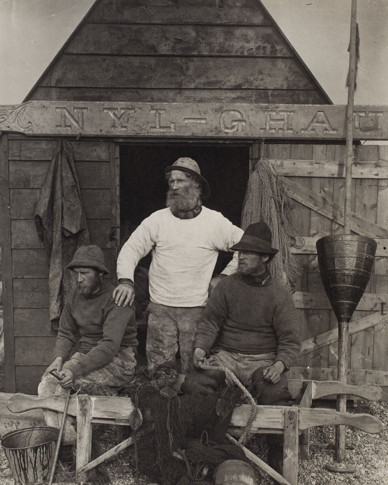 "Peter Henry Emerson (English, 1856-1936) East Coast Fishermen, ca. 1886, Platinum print, Museum collection.  Born in Cuba to an American father and English mother, Peter Henry Emerson returned to England at age 13 with his mother after the death of his father. He studied medicine, receiving a degree from Kings College in 1879. He began photographing the ""peasants"" who worked the land of Suffolk and Norfolk, attempting to record a way of life that had almost disappeared as a result of industrialization. He advocated a ""naturalistic"" approach to photography, rejecting the artificiality of constructed scenes made from several negatives and combined in the darkroom such as those by Robinson and Rejlander. He believed in photographing ""real"" people in their natural environments, and printed his negatives without manipulation. Influenced by the theories of human vision proposed by German scientist Hermann von Helmholtz, he claimed that a naturalistic photograph should represent the world as the human eye can see it. He proposed his idea of ""differential focusing,"" which involved placing only a selected part of the scene in sharp focus. His theories were controversial, adding to the lively debate about the role of photography in art. His soft-focus, relatively ""pure"" style was recognized by later Pictorialists such as Frederick Evans, Alvin Langdon Coburn and Alfred Stieglitz. After abandoning his medical career in 1886, he began publishing his photographs in portfolios of platinum prints and photogravures. He published Life and Landscape on the Norfolk Broads with T. F. Goodall in 1886, and Pictures of East Anglian Life in 1888. His landmark manual Naturalistic Photography for Students of the Art appeared in 1889, but his arguments for photography as an independent art were retracted in 1890 with his release of The Death of Naturalistic Photography. Despite this, he received the Royal Photographic Society Progress Medal for work in artistic photography in 1895. Reviewing the third edition of Naturalistic Photography (1899) for Camera Notes, Alfred Stieglitz wrote that while the book ""had struck a blow which shattered idols without mercy,""…""to it pictorial photography owes the stability which it now enjoys."""