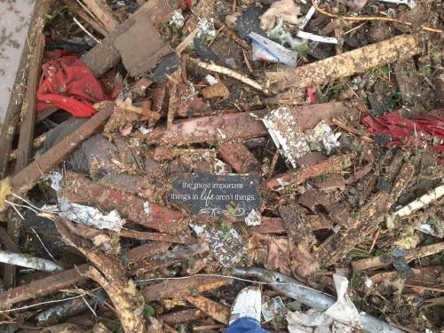 ornamentedbeing:  drewleann:  Picture taken in the tornado rubble in Moore, OK. My prayers are with all of the families affected in today's events.  Keep in mind that prayers have no borders.