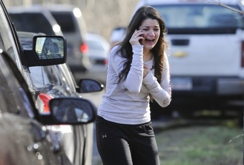 f-launt:  If you haven't heard, Newtown, Conneticut had a school shooting this morning. At an elementary school. This girl, is waiting to find out if her dad is still alive or not. There are reported 27 dead, 18 of them were children. The parents of these children are going to come home, look under their Christmas tree, and see all of those unwrapped presents. 27 families Christmas morning will turn into funerals. I'm so sorry to everyone who was affected by this, and I don't know what makes people feel the need to be so cruel. RIP.