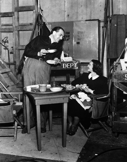 Director Fritz Lang and Sylvia Sidney have lunch on the set of You and Me.