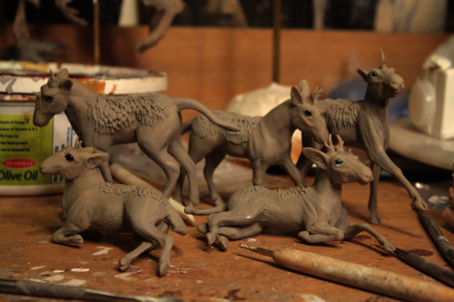 Kirin foals, ahoy! They'll be painted up and for sale on etsy sometime in the next few days/ week. I'm thinking about $125-$150 for them, on the cheaper range because of their size.  Polymer clay over wire and foil, each is about 2-3 inches long.