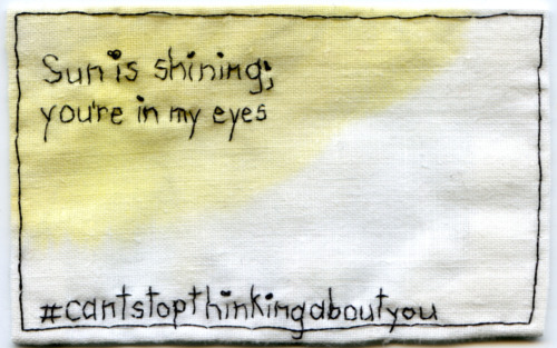Text by @EmbroideryPoems. The sun is shining; you're in my eyes. #cantstopthinkingaboutyou Embroidery and watercolor on fabric. 2013.