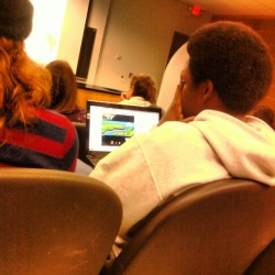 Is this guy really playing Mario in class? In college during a lecture? Really?… Smh