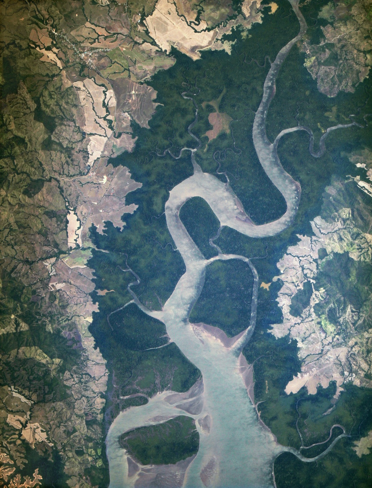 "New ISS Eyes See Rio San Pablo In January 2013, a new Earth-observing instrument was installed on the International Space Station (ISS). ISERV Pathfinder consists of a commercial camera, a telescope, and a pointing system, all positioned to look through the Earth-facing window of ISS's Destiny module. ISERV Pathfinder is intended as an engineering exercise, with the long-term goal of developing a system for providing imagery to developing nations as they monitor natural disasters and environmental concerns. The image above is the ""first light"" from the new ISERV camera system, taken at 1:44 p.m. local time on February 16, 2013. It shows the Rio San Pablo as it empties into the Golfo de Montijo in Veraguas, Panama. It is an ecological transition zone, changing from agriculture and pastures to mangrove forests, swamps, and estuary systems. The area has been designated a protected area by the National Environmental Authority (ANAM) of Panama and is listed as a ""wetland of international importance"" under the Ramsar Convention. (Note that the image is rotated so that north is to the upper right.) ""ISERV's full potential is yet to be seen, but we hope it will really make a difference in people's lives,"" said principal investigator Burgess Howell of NASA's Marshall Space Flight Center. ""For example, if an earthen dam gives way in Bhutan, we want to be able to show officials where the bridge is out or where a road is washed out or a power substation is inundated. This kind of information is critical to focus and speed rescue efforts."""
