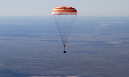 Welcome Home to the first 'Space Tumblrist': Chris Hadfield The Russian Soyuz space capsule, carrying US astronaut Thomas Marshburn, Russian cosmonaut Roman Romanenko and Canadian astronaut Chris Hadfield, descends about 90 miles south-east of the town of Dzhezkazgan in central Kazakhstan, this morning. Photograph: Sergei Remizov/AP And here's Canadian spaceman, photographer and sometime singer Chris Hadfield giving a thumbs up shortly after the landing. Photograph: Mikhail Metzel/AFP/Getty Images