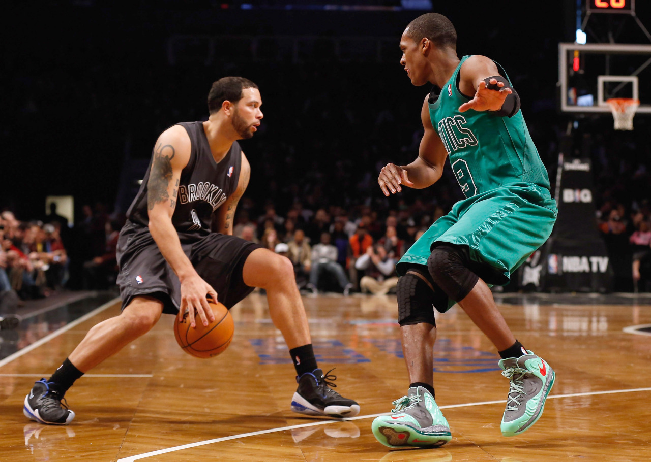 nba:  Rajon Rondo of the Boston Celtics defends against Deron Williams of the Brooklyn Nets at the Barclays Center on December 25, 2012 in the Brooklyn borough of New York City. (Photo by Mike Stobe/Getty Images)  #BIGcolor