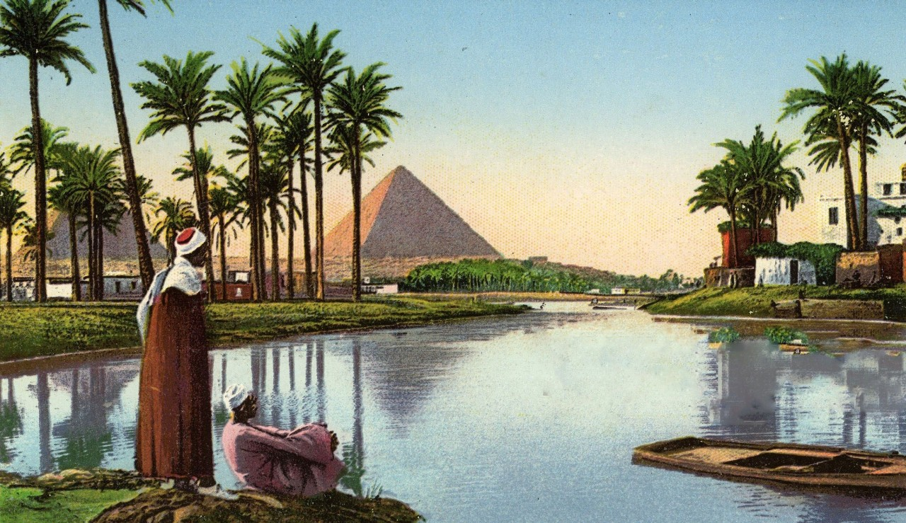 Pyramids by the Nile River Two Egyptian men... — Egypt Museum