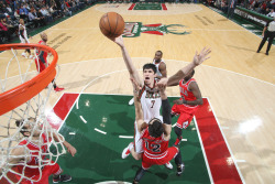 Ersan Ilyasova #7 of the Milwaukee Bucks shoots against Kirk Hinrich #12 of the Chicago Bulls on January 30, 2013 at the BMO Harris Bradley Center in Milwaukee, Wisconsin.   (Photo by Gary Dineen/NBAE via Getty Images)