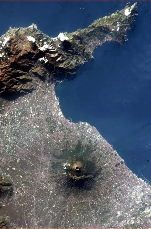 jtotheizzoe:   Mt. Vesuvius from Space As Phil Plait informs us at the link above, this gorgeous shot was taken from the International Space Station on Jan 1, 2013. That so many would desire to live in a place so beautiful, with full knowledge of the possible destruction that this active volcano could wreak on their lives (as it did less than two millennia ago), speaks volumes about us. Sometimes when you take a picture of Earth, it can be a self-portrait of humanity itself. It's a stunningly beautiful place, and that seems to trump danger and risk for a great many people.  (via Bad Astronomy)
