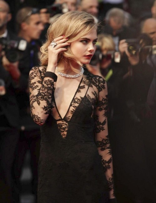 pretaportre:  Cara Delevingne at the Cannes film festival in France wearing a black lace gown from Burberry.