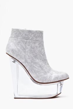 citykid-s:  what-do-i-wear:  Icy Platform Wedge By Jeffrey Campbell.  Q'd not too cool for school