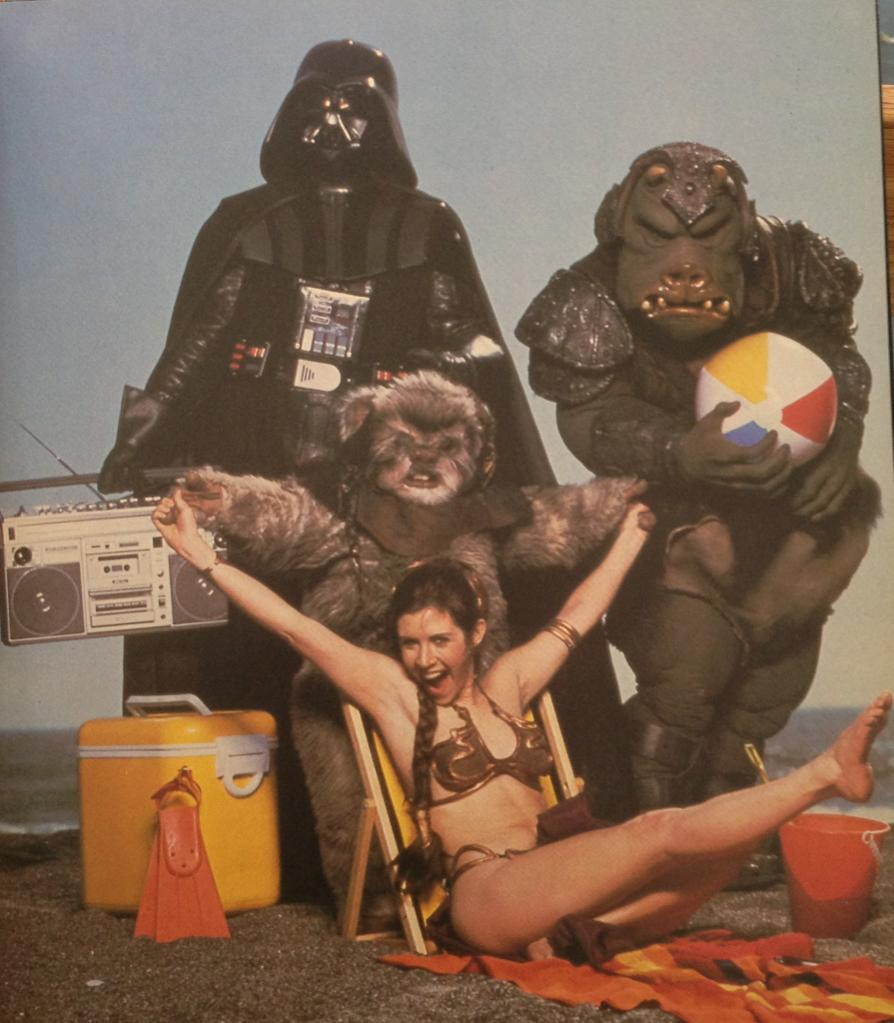 Here's a picture of Princess Leia, an ewok, and Darth Vader and a beach ball