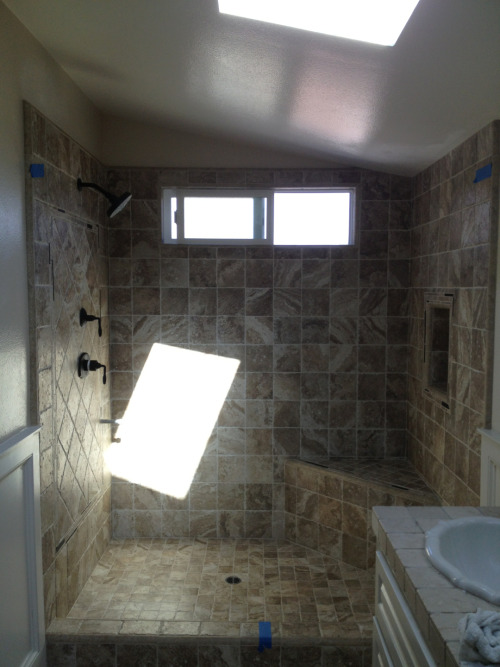 Overview snapshot of the shower. New Milgard window, niche, shower seat, etc. (rectangular glare is from bathroom skylight)