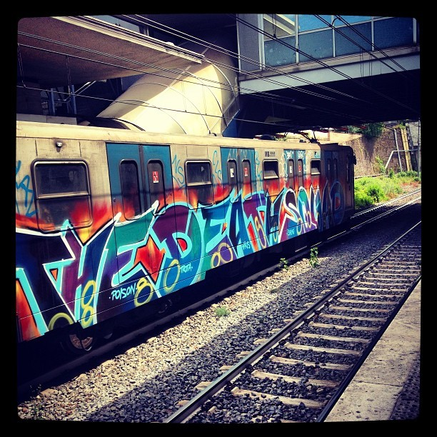 mikit3:  There was graffiti along the entire side of the train #graffiti #rome #metro