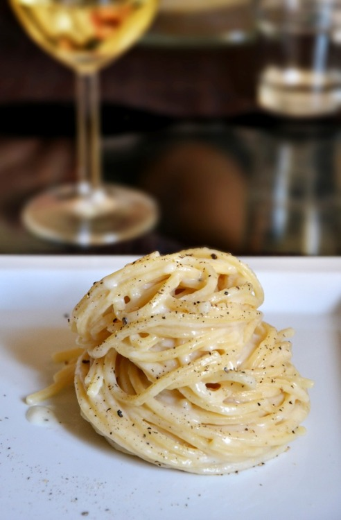 There's another word for pasta and wine like this to either close out a rough day or celebrate a great one. Actually, there are several words. Therapy; necessity; godliness. basilgenovese:   Cacio e Pepe