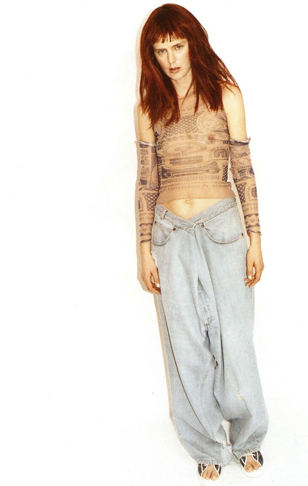 "crystallizations:  ""Maison Martin Margiela Retrospective"": Stella Tennant wearing Maison Martin Margiela, photographed by Juergen Teller for Purple Magazine, Spring 2007 Tattoo top from S/S 1989, oversized jeans from F/W 2000, and peep toe denim trainers from S/S 2007"