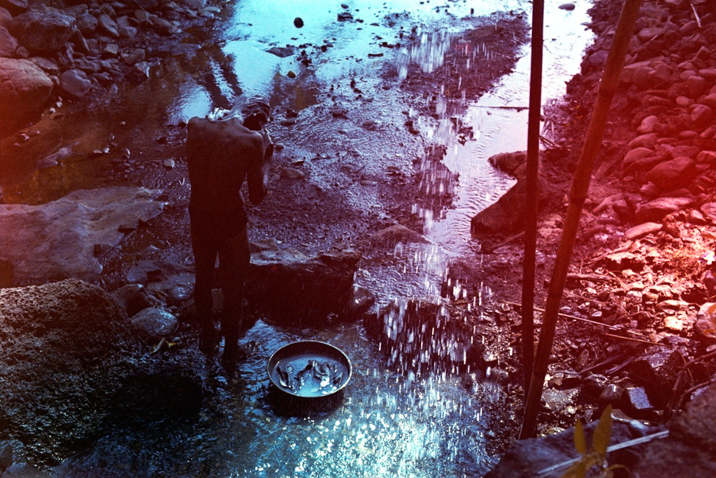 Man washing his hair, India, February 2013 - Kolor film in Nikon F100