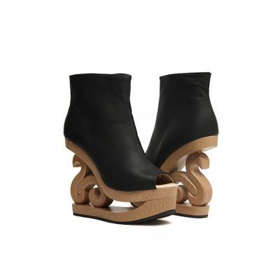(via Peeptoe Cut-out Wedge Booties)