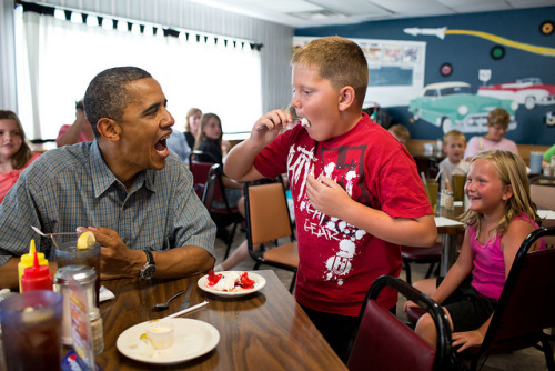 "How @whitehouse celebrates Pi Day.  This July 2012 photo captures Obama eating at Kozy Corners restaurant in Ohio. ""Anyone want to try a piece of my strawberry pie?"" Obama asked fellow diners. This boy said yes.  (Photo by official White House photographer Pete Souza)"
