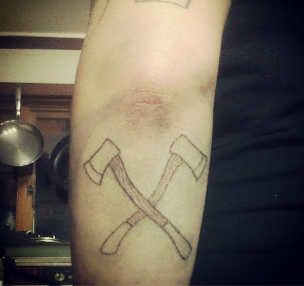 crossed axes on the back of my own arm! hard to reach but i did it!