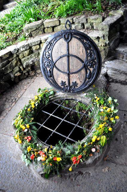 onetwistedpixie:  The Chalice Well, Glastonbury, England Also known as 'The Well of Avalon'. Archaeological evidence suggests that the well has been in almost constant use for at least two thousand years. Water issues from the spring at a rate of 25,000 gallons per day and has never failed, even during drought. The water is believed to possess healing qualities. The Well is often portrayed as a symbol of the female aspect of deity, with the male symbolised by Glastonbury Tor. As such, it is a popular destination for pilgrims in search of the divine feminine, including Pagans. The Well is however popular with all faiths and in 2001 became a World Peace Garden.