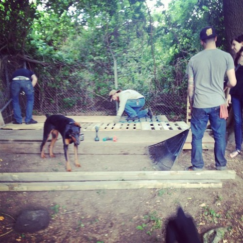 Building a pallet stage for Sat nights show/swap meet (at Vanguard Compound)