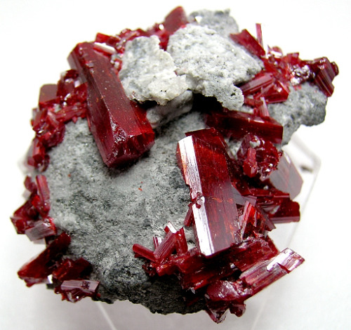 fuckyeahmineralogy:  Realgar, from Romania.  Realgar is an arsenic sulfide, and should not be stored in direct sunlight, since it will disintegrate into a yellow powder.