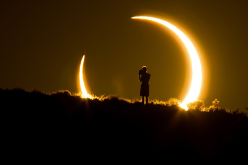 An Onlooker Witnesses the Annular Solar Eclipse as the Sun Sets on May 20, 2012Photo and caption by Colleen Pinski (Peyton, CO)