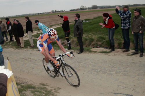 Johan Van Summeren | Paris-Roubaix 2012 on Flickr.Via Flickr: Paris–Roubaix is a one-day professional bicycle road race in northern France near the Belgian frontier. From its beginning in 1896 until 1967 it started in Paris and ended in Roubaix (hence the name); since 1968 the start city has been Compiègne (about 60 kilometres (37 mi) north-east from Paris center) whilst the finish is still in Roubaix. Famous for rough terrain and cobblestones (setts),[n 1] it is one of the 'Monuments' or Classics of the European calendar, and contributes points towards the UCI World Ranking. It has been called the Hell of the North, a Sunday in Hell (also the title of a film about the 1976 edition of the race), the Queen of the Classics or la Pascale: the Easter race.[1] The race is organised by the media group Amaury Sport Organisation annually in mid-April. First run in 1896, Paris–Roubaix is one of cycling's oldest races. It is well known for the many 'cobbled sectors' over which it runs, being considered, along with the Ronde van Vlaanderen and Gent–Wevelgem to be one of the cobbled classics. Since 1977, the winner of Paris–Roubaix has received a sett (cobble stone) as part of his prize.[2] In recent years, the terrain over which Paris–Roubaix runs has led to specialized bikes, with unique frames and wheels, being used. Wheel punctures and other mechanical problems are extremely common because of this terrain, and often play a part in who is able to ultimately make it to Roubaix with momentum. Despite the high esteem with which the race is seen, some notable cyclists throughout history have regarded the race as a joke because of its difficult conditions. The race has also seen several controversies over the years, with many seeming winners of the race disqualified for various reasons. The course is maintained by Les Amis de Paris–Roubaix, a group of fans of the race formed in 1983. The forçats du pavé seek to keep the course as safe as possible for riders while maintaining its difficulty.