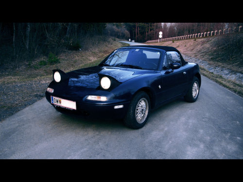 My new 97 Mazda MX5 NA Classic - still stock on the outside.