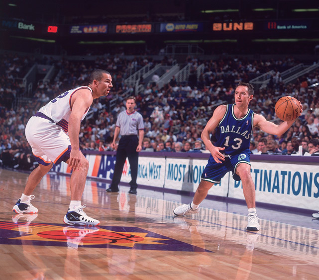 Steve Nash attempts to find an opening as Jason Kidd D's him up during a 1999 Suns-Mavs game. More than a decade later, the two are still among the NBA's top point guards. (John W. McDonough/SI) GALLERY: Rare Photos of Jason Kidd | Steve Nash