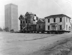 "memoriastoica:  ""The Castle"" and ""The Saltbox,"" old historic Bunker Hill homes, sit on blocks awaiting their removal to Montecito Heights. Circa 1969."