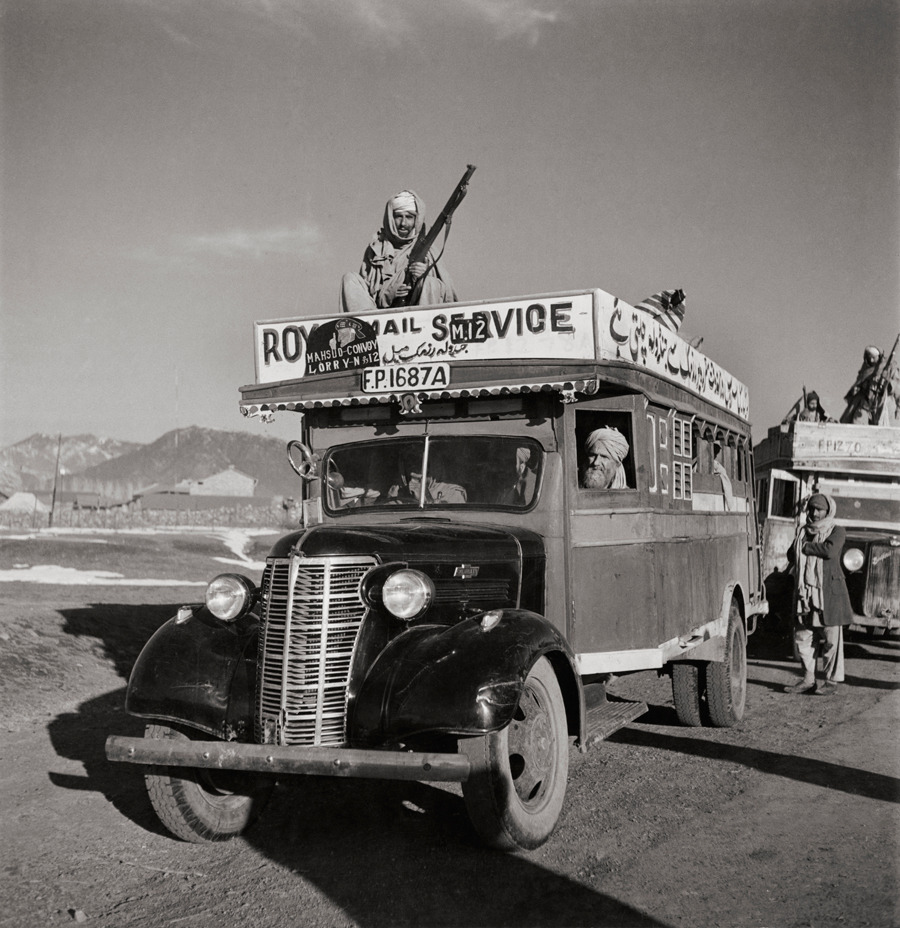 A Royal Mail bus with armed guards heads out from Razmak to Jandola, April 1946.Photograph by Maynard Owen Williams, National Geographic