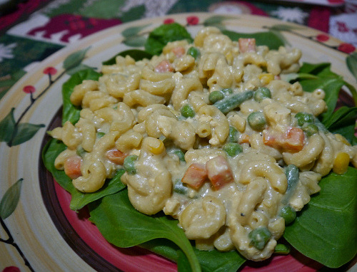 My own take on the Cheesy Mac & Greens from Tami Noyes's American Vegan Kitchen (page 164). With quadruple the nooch, mixed with frozen veggies, and served on spinach.
