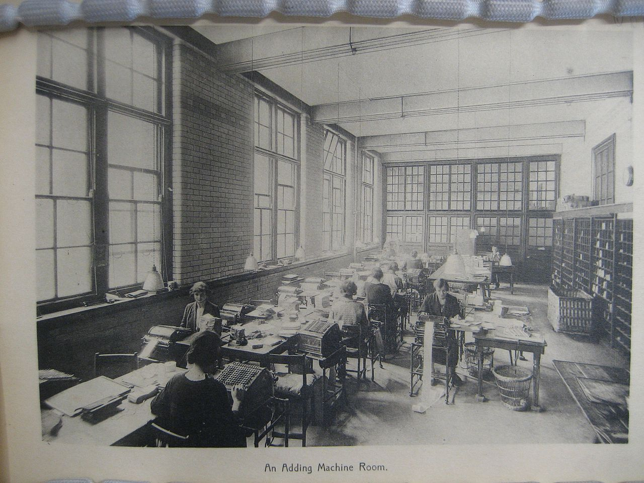 Clerks operating adding machines. Blythe house, c. 1924