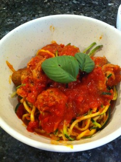 Oodles and zoodles of yum! Meatballs with zucchini noodles topped with basil from the garden