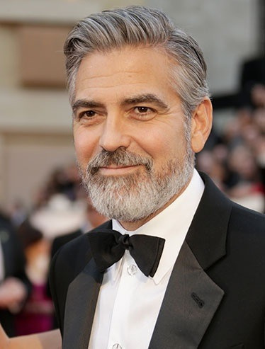 First it was Justin Timberlake at the SAG awards and now even George Clooney is rocking the parted pompadour hair at the Oscars. If I'm ever going to figure out how to style my hair like this, I need to learn how to use a blow dryer.