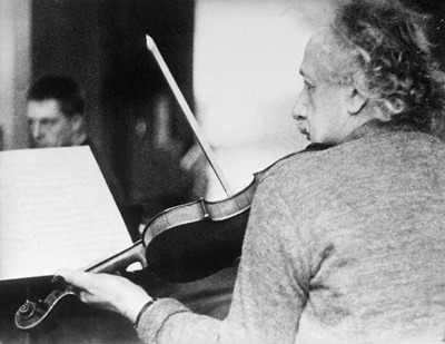 "sagansense:  Einstein On Creative Thinking: Music and the Intuitive Art of Scientific Imagination  For Einstein, insight did not come from logic or mathematics. It came, as it does for artists, from intuition and inspiration. As he told one friend, ""When I examine myself and my methods of thought, I come close to the conclusion that the gift of imagination has meant more to me than any talent for absorbing absolute knowledge."" Elaborating, he added, ""All great achievements of science must start from intuitive knowledge. I believe in intuition and inspiration…. At times I feel certain I am right while not knowing the reason."" Thus, his famous statement that, for creative work in science, ""Imagination is more important than knowledge"".  But how, then, did art differ from science for Einstein? Surprisingly, it wasn't the content of an idea, or its subject, that determined whether something was art or science, but how the idea was expressed. ""If what is seen and experienced is portrayed in the language of logic, then it is science. If it is communicated through forms whose constructions are not accessible to the conscious mind but are recognized intuitively, then it is art"". Einstein himself worked intuitively and expressed himself logically. That's why he said that great scientists were also artists.  Einstein first described his intuitive thought processes at a physics conference in Kyoto in 1922, when he indicated that he used images to solve his problems and found words later. Einstein explicated this bold idea at length to one scholar of creativity in 1959, telling Max Wertheimer that he never thought in logical symbols or mathematical equations, but in images, feelings, and even musical architectures. Einstein's autobiographical notes reflect the same thought: ""I have no doubt that our thinking goes on for the most part without the use of symbols, and, furthermore, largely unconsciously"". Elsewhere he wrote even more baldly that ""no scientist thinks in equations"".  Anyone in science education reading this?!  Einstein only employed words or other symbols (presumably mathematical) — in what he explicitly called a secondary translation step — after he was able to solve his problems through the formal manipulation of internally imagined images, feelings, and architectures. ""I very rarely think in words at all. A thought comes, and I may try to express it in words afterwards,"" he wrote.  Einstein expanded on this theme in a letter to fellow mathematician Jacques Hadamard, writing that ""the words of the language, as they are written or spoken, do not seem to play any role in my mechanism of thought. The psychical entities which seem to serve as elements in thought are certain signs and more or less clear images which can be 'voluntarily' reproduced and combined…. The above mentioned elements are, in my case of visual and some of a muscular type…. Conventional words or other signs [presumably mathematical ones] have to be sought for laboriously only in a secondary stage, when the associative play already referred to is sufficiently established and can be reproduced at will"".  In other interviews, he attributed his scientific insight and intuition mainly to music. ""If I were not a physicist,"" he once said, ""I would probably be a musician. I often think in music. I live my daydreams in music. I see my life in terms of music…. I get most joy in life out of music"". His son, Hans, amplified what Einstein meant by recounting that ""whenever he felt that he had come to the end of the road or into a difficult situation in his work, he would take refuge in music, and that would usually resolve all his difficulties"". After playing piano, his sister Maja said, he would get up saying, ""There, now I've got it"". Something in the music would guide his thoughts in new and creative directions.  No historian of science seems to have taken these musical and intuitional comments of Einstein seriously, but we think there is something very important to be gleaned from his personal testimony. What did Einstein mean when he told Wertheimer that he often thought in terms of musical architectures? We can't know for certain at this far remove, and Wertheimer never asked, but the engineer-composer Robert Mueller investigated further.  According to Mueller, Einstein's friend Alexander Mozskowski says ""that Einstein recognized an unexplainable connection between music and his science, and notes that his [Einstein's] mentor Ernst Mach had indicated that music and the aural experience were the organ to describe space"". Music also embodies time. Could music have therefore provided Einstein with a connection between time and space through its combination of architectonic, or structural, nature combined with its spatial and temporal aspects? Mueller has conjectured that the physicist's ""disposition to architectonic logics of abstraction was formulated by Einstein's early musical experiences, and even enlarged by a constant struggle for musical experiences which helped him build a rich mental perceptual fabric of space and time in which to perform his scientific theorizing"".  These speculations about music, space and time in Einstein's imaginative thinking certainly fit with something the physicist told the great pioneer of musical education, Shinichi Suzuki: ""The theory of relativity occurred to me by intuition, and music is the driving force behind this intuition. My parents had me study the violin from the time I was six. My new discovery is the result of musical perception"". They also fit with the manner in which Einstein expressed his greatest praise for a fellow scientist. Neils Bohr's work on the structure of the atom, Einstein said, was ""the highest form of musicality in the realm of thought"".  Wow! Anyone looking for connections between music, mathematics, and physics? How about intuition and reason? Einstein shows us how it all connects. But what do our students typically get, especially in high school and college? They get math without music. They get science without images, feelings and intuition. They get knowledge without imagination. Not only does intuition go undeveloped, many math and science teachers do not give credit to answers (even though they may be correct) that are not explicated by detailed logic. What these teachers appear not to understand is that translating intuitive insights into words or mathematical symbols is a secondary process that can - and should be — be taught just as explicitly as translating from one language and another. So much for Einstein's admission that he often had a feeling he was right without being able to explain it. So much for experiencing space-time through music. So much for working out ideas in images and feelings and musical architectures for which there are no words or symbols. So much for sitting down at the piano and letting the music show the way.  No wonder so many of our students don't like math and science: what is there to imagine and feel? Where is the art in their learning?sources/references."
